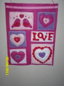 My favorite Valentine's Day Decor: A Simple Banner I handstitched.