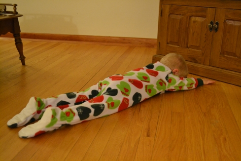Elijah thinks the pjs are perfect for sliding around on the hardwood floors.