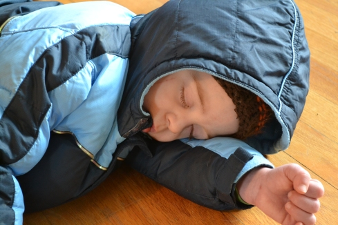 Eli was so tired after playing outside that he fell asleep on the floor!