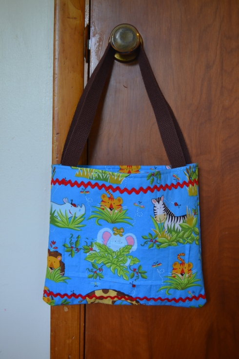 I made this tote bag for my son this past week.  The outside has a pocket that holds 8 crayons.