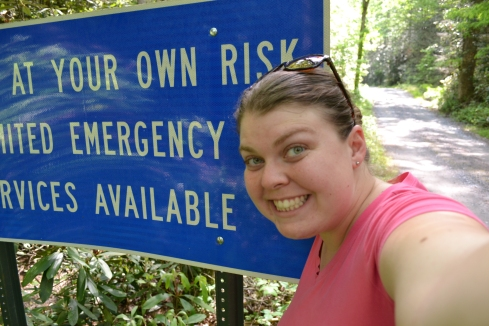 "I'm super bad at taking photos of myself with my new camera.  I thought this sign was a little crazy that I found on vacation.  It read: ""Enter at your own risk.  Limited Emergency Services Available."""
