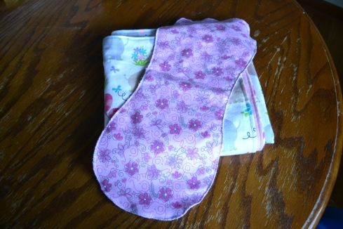 I sewed two burp cloths this week.  These are contoured and will not slip off your shoulder.