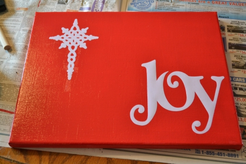 I made a Christmas canvas as a thank you to a couple in our church who allowed our family to stay at their cabin while they were visiting.